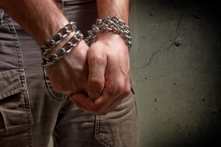 Male hands with chain wrapped around them, prisoner concept Stock Photo - 17101911