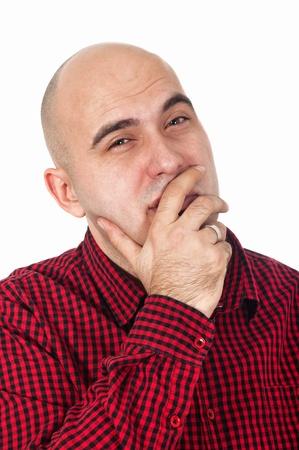 homme chauve: Jeune adulte, homme chauve pens�e, la main sur la bouche.