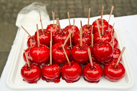 Beautiful tasty red candy apples on a table. photo
