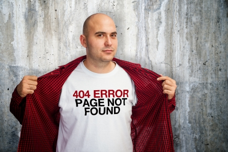 Man showing his white t-shirt with 404 error message Stock Photo - 17193263