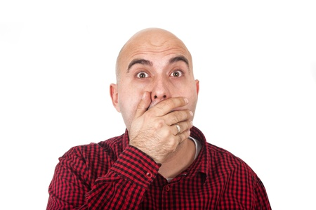 silenced: Young adult bald man with hand on mouth