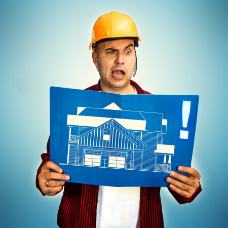 Construction worker with blueprint making a funny face photo