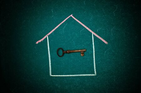 key board: Drawing of a house and a vintage key on a green chalkboard