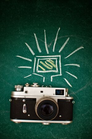 lens unit: Retro style camera on a wooden table plate Stock Photo