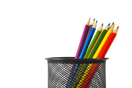 pencil holder: Wood color pencils in black metal pencil holder over a white background Stock Photo