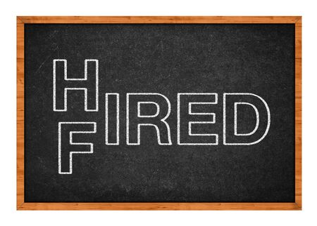 hired: Hired or fired concept, two words handwritten on a chalkboard