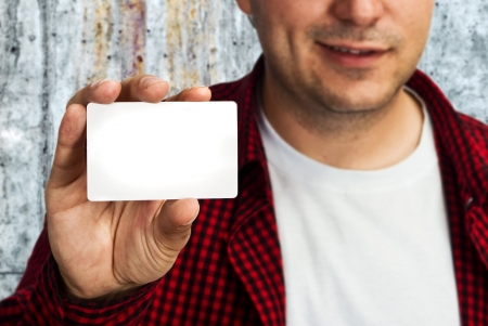 Construction worker holding a blank business card, business introduction concept  photo