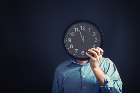 enough: Businessman with black clock in front of his head, deadline concept. Not enough time to finish the job.