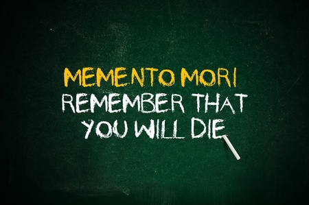 memento: Memento mori, remmeber that you will day. Latin quote handwritten with chalk on a green school board.