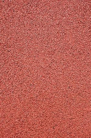 La textura de la superficie artificial corriendo para el deporte del atletismo de pista y campo.