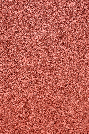 athletics track: Texture of the artificial running surface for the sport of track and field athletics.