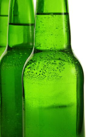 Green beer bottles over white background. photo