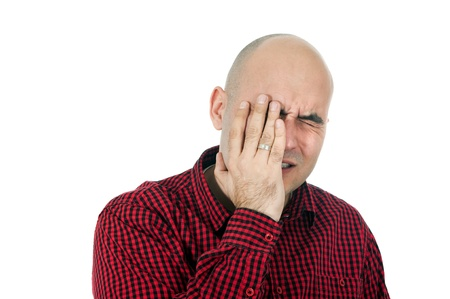 forgetfulness: Memory loss, portrit of adult bald man trying to remember something, hand on face.