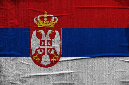 Grunge Serbian flag, image is overlaying a detailed grungy texture photo