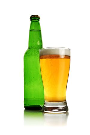 Green bottle and a glass of cold fresh beer over white background. photo