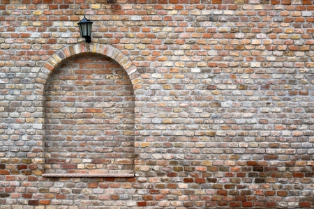 beautiful brick wall and a black street lantern photo