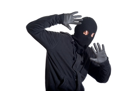 criminality: Catch the burglar concept, thief with balaclava caught, isolated on white background