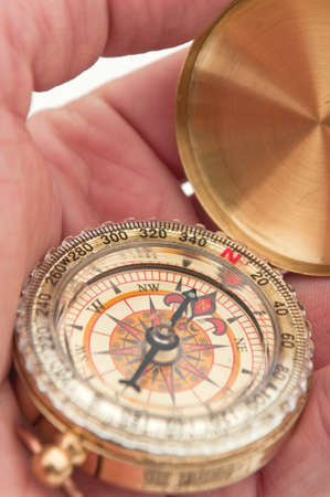 navigate: Man holding compass in hand, navigation concept.