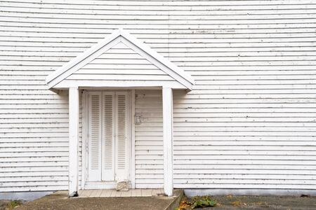 backdoor: White wooden house backdoor on a clody autumn day Stock Photo