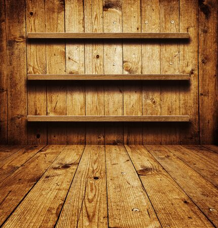 Vintage wooden bookshelf over a grungy background photo