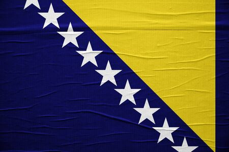 overlaying: Grunge flag of Nosnia and Herzegovina, image is overlaying a detailed grungy texture