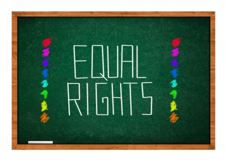 rasa: Equal rights message on green chalkboard with wooden frame.