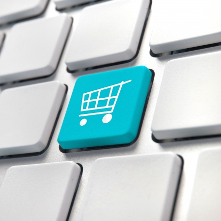 e store: Shopping cart computer key, online internet buying concept