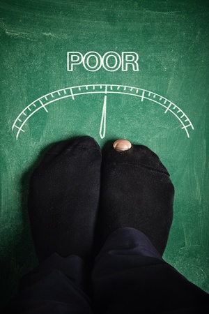pauperism: Poor man standing at poverty meter, conceptual image