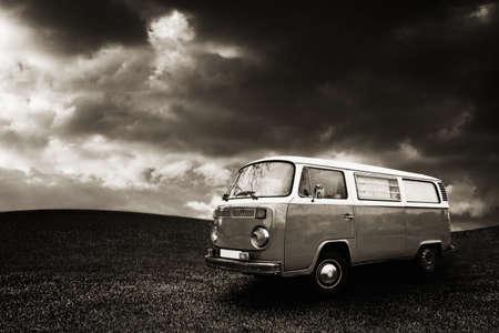 hippy: Vintage hippie van in the grass field