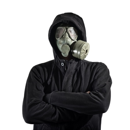 Man in dark clothes wearing a classic gas mask respirator over a white background