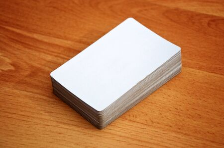 Stack of business cards with rounded corners over a wooden background Stock Photo - 18975028