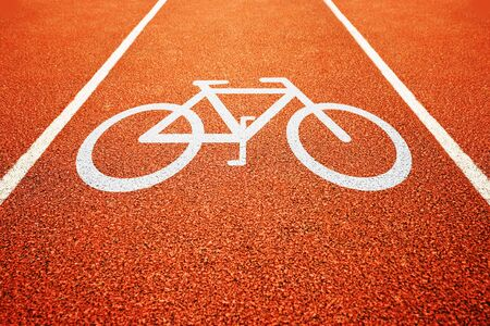bicycle lane: Bicycle lane mark. White sign for bicycle track in the park. Stock Photo