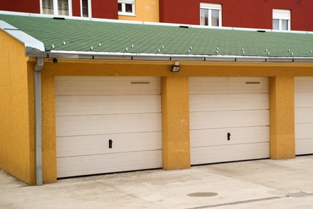 car garage: Car garage in a residential area, urban scenery. Stock Photo