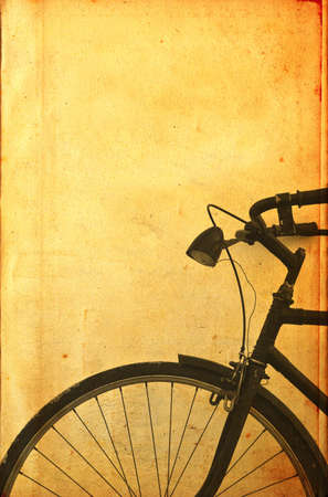 Old vintage black bicycle leaning on the wall  photo
