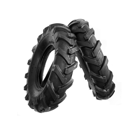 unused: New, unused black cultivator tyres  Agriculture and farming background image  Stock Photo