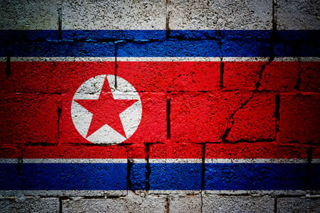 overlaying: North korea grunge flag  Flag od North Korea overlaying grunge texture