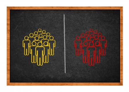 polarization: Conceptual drawing on a blackboard showing two groups of people, symbolizing the concept of division, conflict, polarization.