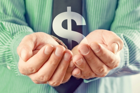us dollar: Dollar symbol in hands. Businessman holding dollarsymbol in cupped hands. Stock Photo