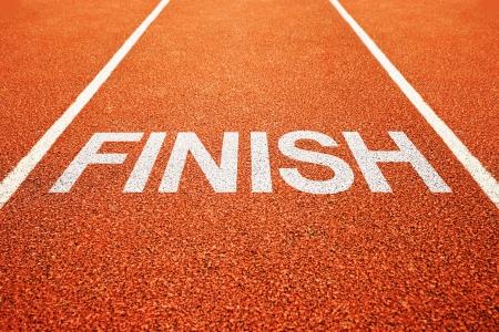 running race: Finish on athletics all weather running track