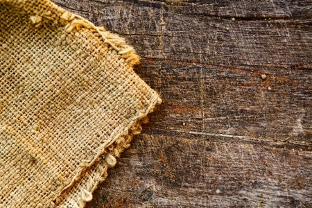 jute: Burlap jute canvas texture and old wood texture as background Stock Photo