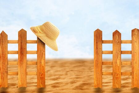 sun hat: Beautiful wooden fence with natural wood pattern slats and sun hat. Summer season concept.