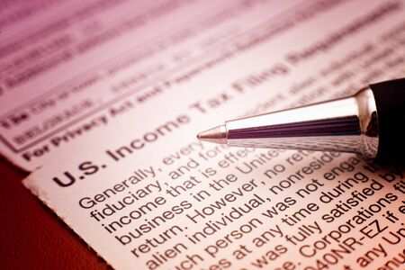 tax law: US tax form 1042, foreign persons US source income subject to Witholding Stock Photo