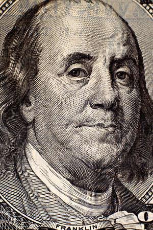 Benjamin Franklin portrait on hundred american dollar bill.