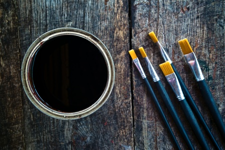 Paint brushes and paint can on old wood background. Stock Photo - 19748604