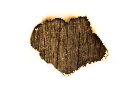 burnt wood: White paper with burned hole on old wood background
