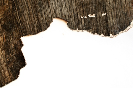 White paper with burned edges on old wood background Stock Photo - 20141177