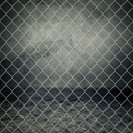 old fence: Obsolete gray grunge concrete room closed with chain link fence