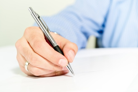 letter of application: Businessman signing contract. Business man in blue shirt is signing agreement document. Stock Photo