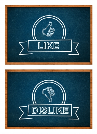 dislike: Like and Dislike button hand drawn with rthe chalk on the classroom chalkboard.