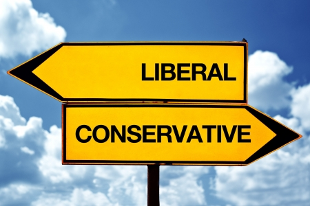 conservative: Liberal or conservative, opposite signs. Two blank opposite signs against blue sky background.